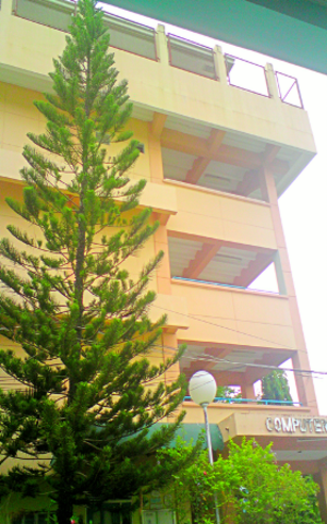 Wesleyan University Philippines - Side entrance of the Computer Studies Building which houses the Office of the Student Affairs, WUPFSA Office, Tactical Office, Genre Office at Level 1 and DWUP FM Station at Level 5.