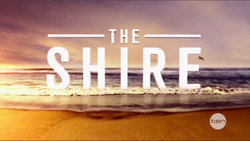 The Shire Text spread across a beach