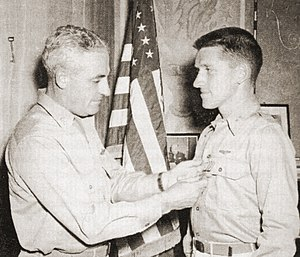 Hector Macpherson Jr. - Capt. Hector Macpherson, Jr. receiving the Distinguished Flying Cross from Maj. Gen. Nathan Farragut Twining, summer 1944.