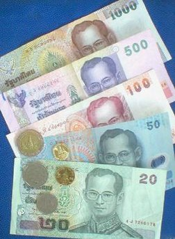 Baht banknotes and coins issued by the Bank of Thailand.