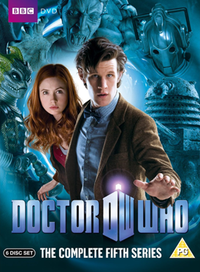 "A DVD boxset cover consisting of a man with black hair reaching forward over a logo which says ""Doctor Who"". He is wearing a bowtie and tweed jacket. Looking out from behind him is young woman with red hair, wearing a red shirt and brown jacket. The background is blue and shows a masked reptilian humanoid, a statue with open jaws, the head of a robot, and a robot-like creature with an eyestalk."
