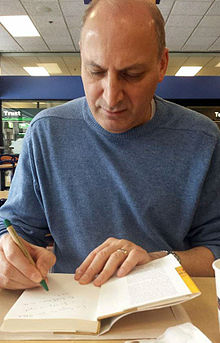 Ramin Jahanbegloo signing his book in University of California, Irvine.jpg