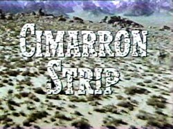 Title Cimarron Strip superimposed on a view of the landscape