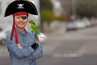 Staff portrait of Terry Chay, edited to add pirate outfit