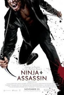 "A white poster. Above and in the center, is a young Asian male wearing a black leather jacket and black pants. In his right hand, he is holding a blade connected to a metal chain behind his back, with the other end of the chain being held in his left hand. He is injured, stumbling forward grimacing in pain. There are splatterings of blood all around. Below reads the lines, ""Ninja Assassin"". Beneath that are the film credits with the line, ""November 25"" appearing in a larger font than the rest of the surrounding words."