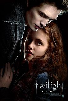 "A pale young man fills the top left of the poster, standing over a brown-haired young woman on the right, with the word ""twilight"" on the lower right."