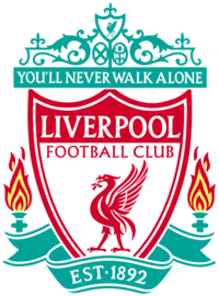 "The words ""Liverpool Football Club"" are in the centre of a pennant, with flames either side. The words ""You'll Never Walk Alone"" adorn the top of the emblem in a green design, ""EST 1892"" is at the bottom."