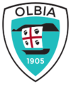 U.S. Olbia 1905 badge.png