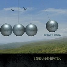 "Four grey balls make up half of a giant Newton's Cradle. The ball on the right is midway through a swing and has the Majesty symbol on it. The word ""Octavarium"" is written under this ball. Two birds fly above the stationary balls. The background is a set of green hills with a blue, partially cloudy sky. Along the bottom of the image is a dark strip with ""Dream Theater"" written in the traditional Dream Theater font to the right. The front of the jacket (also the front of the case when folded out) reveals a full Newton's Cradle with 8 balls. This physics toy always repeats the same motion over and over again, emphasizing this album's theme. There are also 5 birds in the picture, forming a piano octave - the balls being the white keys and the birds being the black keys. This theme of octaves and moving in circles is continued throughout the entire album. On the back of the jacket, you'll see part of a piano. Note that each octave on a piano has 8 white keys and 5 black keys. Each white key represents a song off the album - in order, starting with F. In fact, these notes are the minors of the key the song is in. If you look carefully you'll see that the track times on the back of the CD appear to be incorrect. They only add up to 73:26, when any CD player will tell you that the CD is 75:55. Interestingly enough, 5 of the tracks have negative time that makes up the missing 2:18. Not only do each of these negative time tracks represent the accidental, but they are also in the key of the relative minor of the accidental. - 0:00 - 8:07: The Root Of All Evil F - 8:08 - 8:25: Nature Sounds (Negative Time) F# - 0:00 - 5:20: The Answer Lies Within G - 5:21 - 5:33: Pitch Bend (Negative Time) G# - 0:00 - 6:59: These Walls A - 7:00 - 7:36: Wind/Heartbeat/Chimes (Negative Time) A# - 0:00 - 4:29: I Walk Beside You B - 0:00 - 7:16: Panic Attack C - 7:17 - 8:13: Synth Solo (Negative Time) C# - 0:00 - 6:33: Never Enough D - 6:34 - 6:46: Voices Begin (Negative Time) D# - 0:00 - 10:42: Sacrificed Sons E - 0:00 - 24:00: Octavarium F (Octave)"