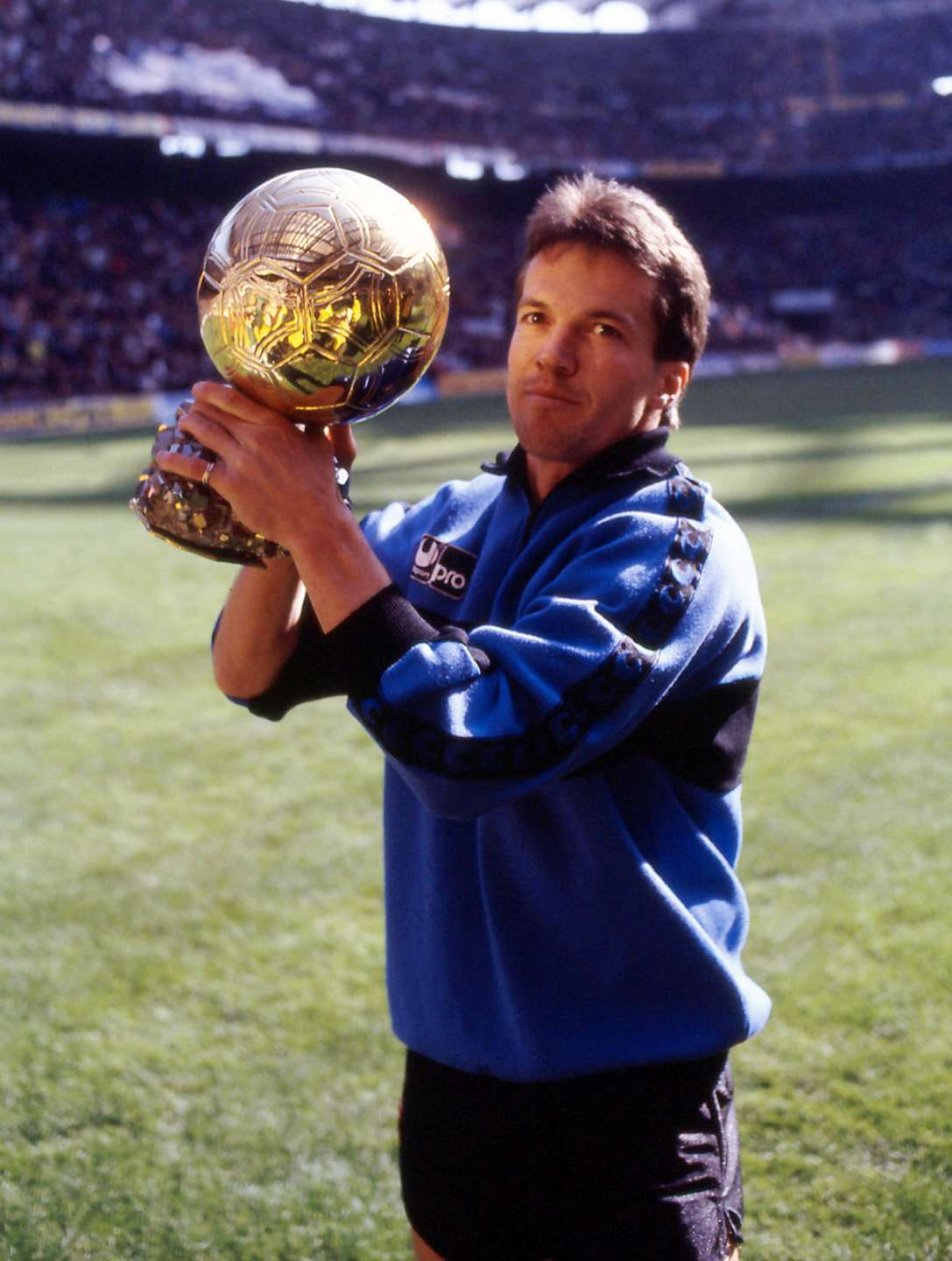 Photograph of Lothar Matthaus winning the golden ball trophy for 1990, Unknown author, public domain image free from copyright