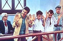 Mario Carotenuto, Gigi Proietti, Francesco De Rosa e Montesano nel cult movie[5] Febbre da cavallo (1976).