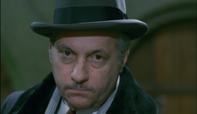 Michel Serrault in una scena del film