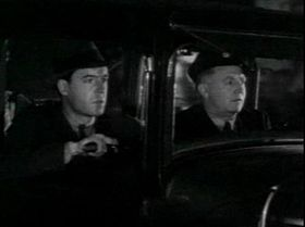 "Scott Kolk/Phil Corrigan '""Agente segreto X-9"" (a sinistra)in uno screenshot del serial Secret Agent X-9 (1937)"