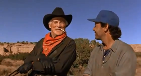 Jack Palance e Billy Crystal in una scena del film
