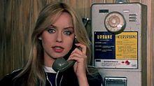 Gloria Guida nel film La liceale nella classe dei ripetenti (1978)