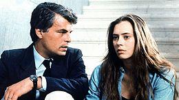 Placido (a sinistra) nel ruolo di Corrado Cattani, accanto a Barbara De Rossi, nella miniserie TV La piovra (1984).