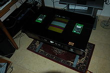 Un mobile arcade non jamma di tipo cocktail. Trattasi del videogioco Taito T.T Block.