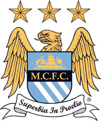 "A crest depicting a shield with a eagle behind it. ON the shield is a picture of a ship, the initials M.C.F.C. and three diagonal stripes. Below the shield is a ribbon with the sesanti ""Superbia in Proelia"". Above the eagle are three stars."