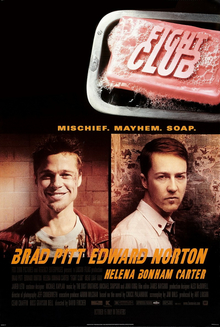 """FIGHT CLUB"" is embossed on a pink bar of soap in the upper right. Below are head-and-shoulders portraits of Brad Pitt facing the viewer with a broad smile and wearing a red leather jacket over a decorative blue t-shirt, and Edward Norton in a white button-up shirt with a tie and the top button loosened. Norton's body faces right and his head faces the viewer with little expression. Below the portraits are the two actors' names, followed by ""HELENA BONHAM CARTER"" in smaller print. Above the portraits is ""MISCHIEF. MAYHEM. SOAP."""