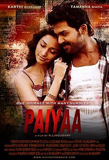 "A poster of the film, Paiyaa. A woman, wearing a violet dress, is resting her head on a man's right shoulder and touching his coat with her right arm. The man is wearing a white shirt with an eagle symbol on it and a striped jacket. The film's has a caption ""One journey with many hurdles."" Below it are the credits of the cast and crew, in red text."