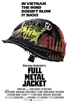 "Against a white backdrop is a camouflaged military helmet with ""Born to Kill"" written on it, a peace sign attached to it, and a row of bullets lined up inside the helmet strap. Above the helmet are the words, ""In Vietnam the wind doesn't blow it sucks."""