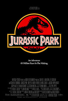 "A black poster featuring a red shield with a stylized Tyrannosaurus skeleton under a plaque reading ""Jurassic Park"". Below is the tagline ""An Adventure 65 Million Years In the Making""."