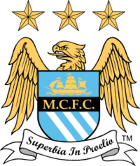 "A badge depicting a shield with an eagle behind it. On the shield is a picture of a ship, the initials M.C.F.C. and three diagonal stripes. Below the shield is a ribbon with the motto ""Superbia in Proelia"". Above the eagle are three stars."