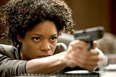 Omega bond-girl-naomie-harris-in-skyfall-wearing-aqua-terra 1 red.jpg