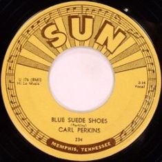 Обложка сингла Карла Перкинса «Blue Suede Shoes» (1956)