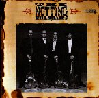 Обложка альбома The Notting Hillbillies «Missing...Presumed Having a Good Time» (1990)