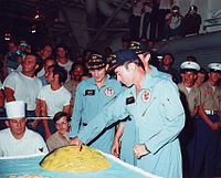 A16 Young cuts lunar cake.jpg