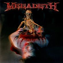 Обложка альбома Megadeth «The World Needs a Hero» (2001)