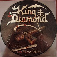 Обложка альбома King Diamond «The Puppet Master» (2003)