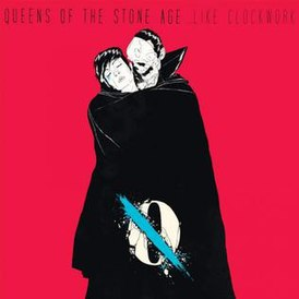 Обложка альбома Queens of the Stone Age «…Like Clockwork» (2013)