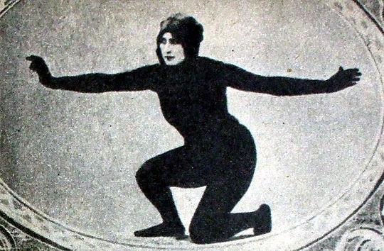 Woman in black bodysuit kneeling