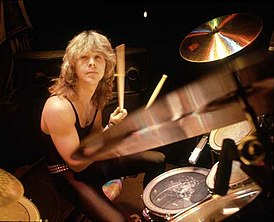 Clive Burr playing drums.jpg