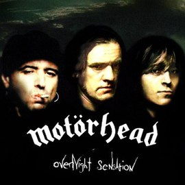 Обложка альбома Motörhead «Overnight Sensation» (1996)