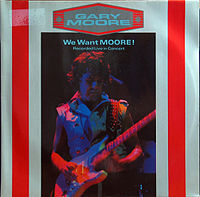 Обложка альбома Гэри Мура «We Want Moore!» (1984)