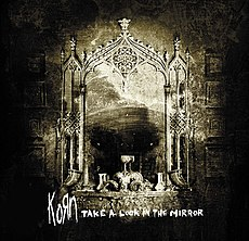 Обложка альбома Korn «Take A Look In The Mirror» (2003)