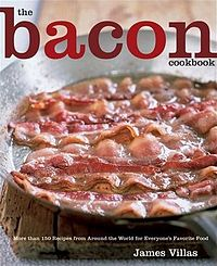 Picture of bacon frying in a pan.