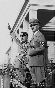 Mussolini and Hitler saluting troops