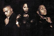 Promo shot of The Firm in 1997, left to right: Nas, Foxy Brown and AZ