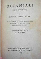 "Close-up of yellowed title page in an old book: ""Gitanjali (Song Offerings) by Rabindranath Tagore. A collection of prose translations made by the author from the original Bengali with an introduction by W. B. Yeats. Macmillan and Co., Limited, St. Martin's Street, London, 1913."""