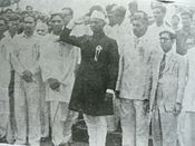 Dadala as head of Provisional Govt taking salute for indian flag at Yanam on liberation Day.JPG