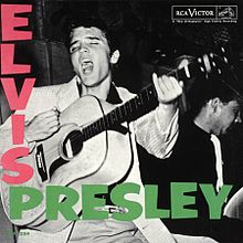 "Album cover with photograph of Presley singing—head thrown back, eyes closed, mouth wide open—and about to strike a chord on his acoustic guitar. Another musician is behind him to the right, his instrument obscured. The word ""Elvis"" in bold pink letters descends from the upper left corner; below, the word ""Presley"" in bold green letters runs horizontally."