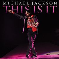 "A picture of a man with dark hair pointing with his right hand to his right. The man is wearing a black jacket with a red shirt and black pants. Behind him, there is a black background with the words ""MICHAEL JACKSON"" in white print and, underneath it, ""THIS IS IT"" written in pink."