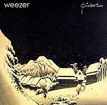"A village in a mountainous landscape during night. A man with a conical hat and a cane, and a saddled horse can be seen in the foreground. At the top left corner of the image is written ""Weezer"", and at top right is ""Pinkerton""."