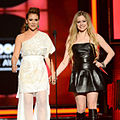 Alyssa Milano & Avril Lavigne at 2013 Billboard Music Awards.jpg