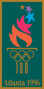 "A fire, emitting many different-colored stars, burns from a cauldron represented by the gold-colored Olympic rings and the number ""100"" acting as the cauldron's stand. The words ""Atlanta 1996"", also written in gold, are placed underneath. The image is situated on a dark green background, with a gold border."
