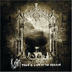 Обкладинка альбому «Follow The Leader» (Korn, 2003)